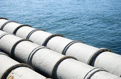 Pipes leading out to sea Stock Photos
