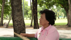 Old lady relax in the park Stock Footage