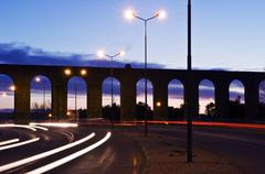 Evora aqueduct by night - stock photo