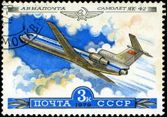 Ussr - circa 1979: a stamp printed in ussr shows the aeroflot emblem and airc Stock Photos