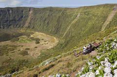 Tourists admiring Caldeira volcano in Faial, Azores - stock photo