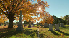 Stock Video Footage of sunshine in a fall cemetery