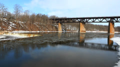 River,dam and railway bridge, a winter scene Stock Footage