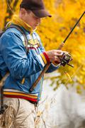 fisherman with spinning. - stock photo
