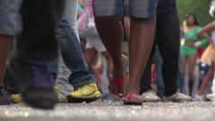 People walking, feet in a parade, legs. (60FPS) gente caminando, pies. - stock footage