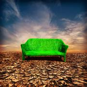 Ecology and global warming concept. grassy sofa at desert under dramatic sky Stock Illustration