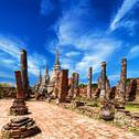 Stock Photo of pagoda at wat phra sri sanphet temple under blue sky. ayutthaya, thailand