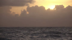 Sunrise over Sea and Clowds - stock footage