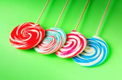 Stock Photo of Colorful lollipop against the background