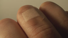 Man Removing A Band Aid From His Finger, Injury, Wound, Medical, Point Of View Stock Footage