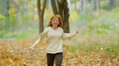 Happy Young Girl In Autumn Park Stock Footage