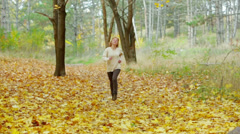 Young Happy Woman Throwing Golden Leaves Stock Footage