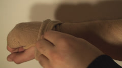 Stock Video Footage of Man Putting Wrist Guard On His Hand, Wrist Pain, Injury, Accident Close Up-Shot