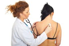 Doctor checkup back woman Stock Photos