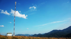mountains. sunny weather. antenna mast cellular network - stock footage