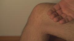 Man Massaging Knee, Knee Injury, Pain, Treatment, Medical, Side-Shot Stock Footage