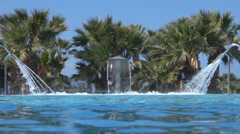 Water Jets Spraying into Luxury Holiday Swimming Pool Stock Footage