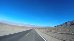 POV road trip Death Valley hot climate blue sky dry Wilderness California USA Stock Footage