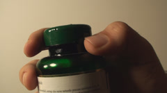Man Opening A Pill Bottle,  Pharmaceutical, Drugs, Medicine, Side-Shot Stock Footage