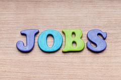 Stock Photo of Employment concept with letters on background