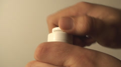Man Opening A Bottle Of Talcum, Treatment, Burns, Powder, Side-Shot Stock Footage