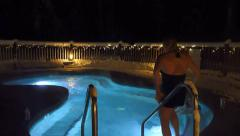 Women in Winter Hot Tub at Night Stock Footage