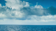 Stock Video Footage of Moving Ocean Scape with Majestic Clouds and Blue Water