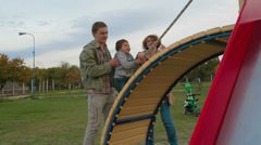 Family on Playground - stock footage