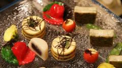 Stock Video Footage of Fruits of the sea canapes decoration closeup