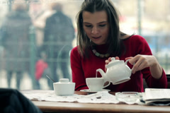 Young pretty woman enjoying tea time NTSC Stock Footage