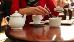 Woman hands sweeten cup of coffee in cafe HD - stock footage
