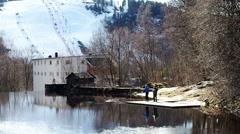 Man practising training fly fishing early in spring, Norway, Scandinavia Stock Footage