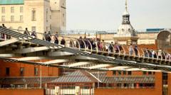 Peiople on Millennium Bridge, London Stock Footage