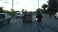 SANTA DOMINGO, DOMINICAN REPUBLIC- Workers going by car to job. Stock Footage