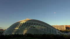 Sunset at The City of Arts and Sciences,L'Hemisfèric, pan view Stock Footage