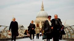 People walking over Millennium Bridge (1) Stock Footage