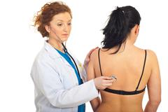 Doctor checkup patient woman - stock photo