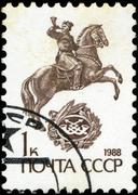 ussr - circa 1988: a stamp printed in ussr shows the monument  on horseback,  - stock photo