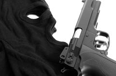 Pistol and mask of a thief over white Stock Photos