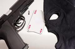 A pair of aces with a mask and a pistol of a thief - stock photo