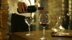 Sommelier pouring wine in a glass Stock Footage