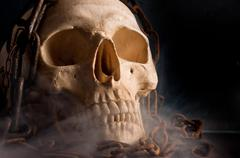 Skull in abstract smoke with chains Stock Photos