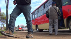 0349 People getting off the bus Stock Footage