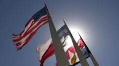 Three Flags With Bright Sun Glare Stock Footage