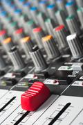 Part of an audio sound mixer with buttons and a slider Stock Photos
