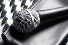 Part of an audio sound mixer with a microphone and its sleeve Stock Photos