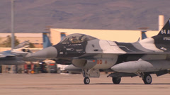 An F-16C Fighting Falcon assigned to the 64th Aggressor Squadron Stock Footage