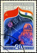 Ussr - circa 1984: a stamp printed in ussr shows the intercosmos cooperative  Stock Photos