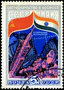 ussr - circa 1984: a stamp printed in ussr shows the intercosmos cooperative  - stock photo