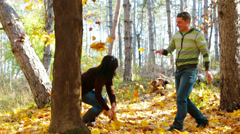 Couple Having  Fun - Slow-motion shot of a young couple throwing dry leaves Stock Footage